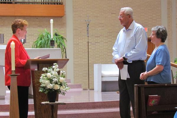 S. Kathy Slesar accepting the Commitment Renewal of Joseph Grauwels